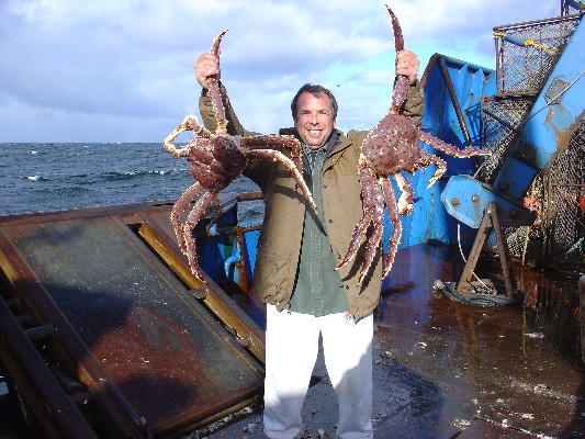 Company president Lance Nylander holding two freshly-caught king crabs.